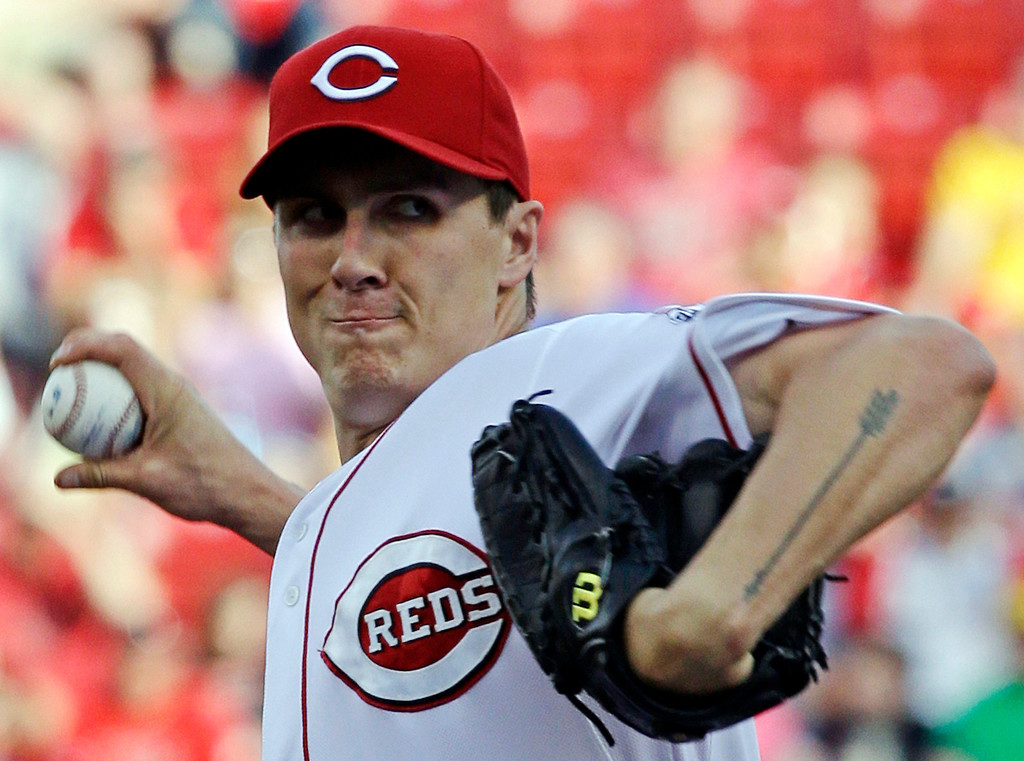 . Cincinnati Reds starting pitcher Homer Bailey throws against the Colorado Rockies in the first inning of a baseball game, Tuesday, June 4, 2013, in Cincinnati. (AP Photo/Al Behrman)