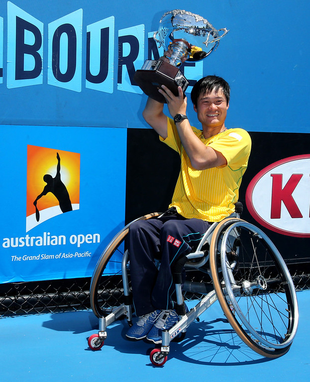 . Shingo Kunieda of Japan holds the championship trophy after defeating Gustavo Fernandez of Argentina during their men\'s wheelchair singles final at the Australian Open tennis championship in Melbourne, Australia, Saturday, Jan. 25, 2014. (AP Photo/Shuji Kajiyama)