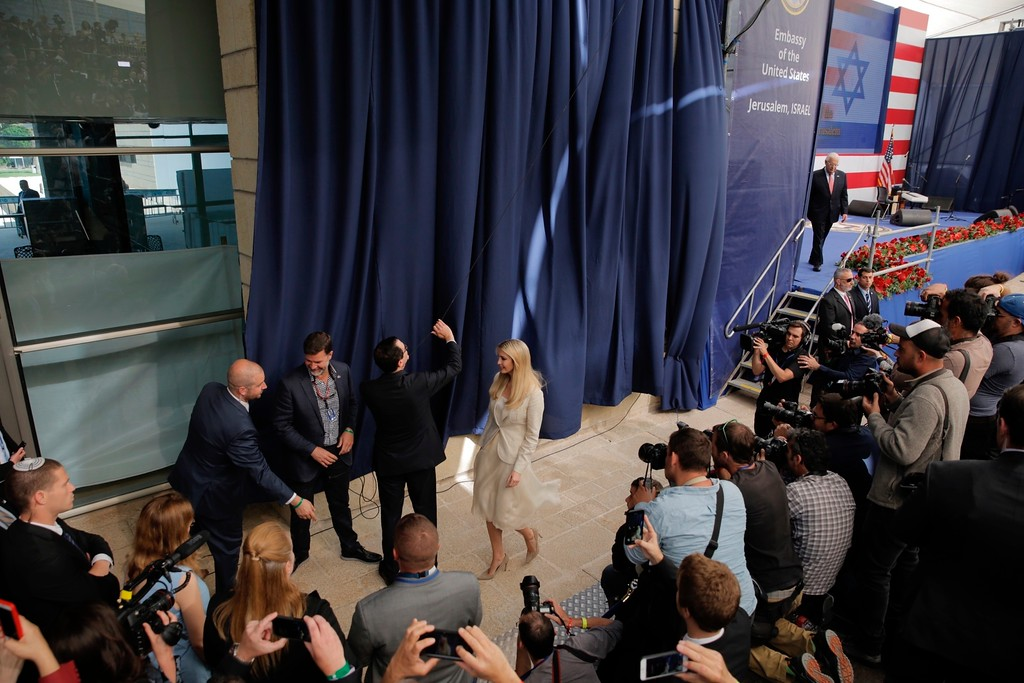 . U.S. President Donald Trump\'s daughter Ivanka Trump, right, and U.S. Treasury Secretary Steve Mnuchin unveil an inauguration plaque during the opening ceremony of the new US embassy in Jerusalem, Monday, May 14, 2018. Amid deadly clashes along the Israeli-Palestinian border, President Donald Trump\'s top aides and supporters on Monday celebrated the opening of the new U.S. Embassy in Jerusalem as a campaign promised fulfilled. (AP Photo/Sebastian Scheiner)