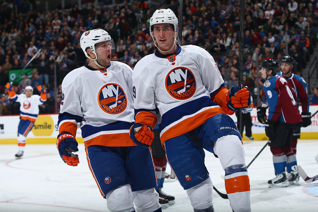 . DENVER, CO - JANUARY 10:  Brock Nelson #29 of the New York Islanders celebrates his goal against the Colorado Avalanche with Josh Bailey #12 of the New York Islanders to tie the score 1-1 in the third period at Pepsi Center on January 10, 2014 in Denver, Colorado. The Islanders defeated the Avalanche 2-1 in overtime.  (Photo by Doug Pensinger/Getty Images)