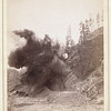 """Blasting away earth while building a railroad into Deadwood.  The photograph is dated """"90."""""""