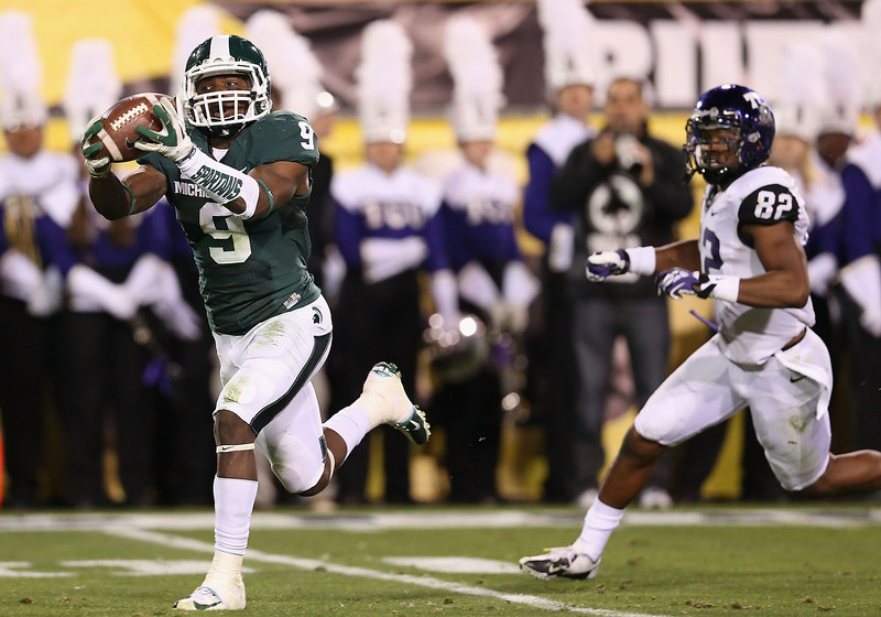 . Safety Isaiah Lewis #9 of the Michigan State Spartans intercepts a second quarter pass during the Buffalo Wild Wings Bowl against the TCU Horned Frogs at Sun Devil Stadium on December 29, 2012 in Tempe, Arizona.  (Photo by Christian Petersen/Getty Images)