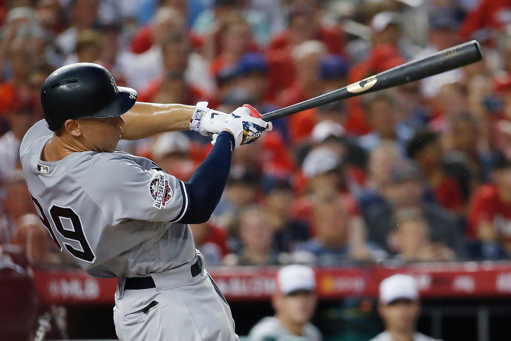 . New York Yankees outfielder Aaron Judge (99) hits a solo home run during the second inning of the Major League Baseball All-star Game, Tuesday, July 17, 2018 in Washington. (AP Photo/Alex Brandon)
