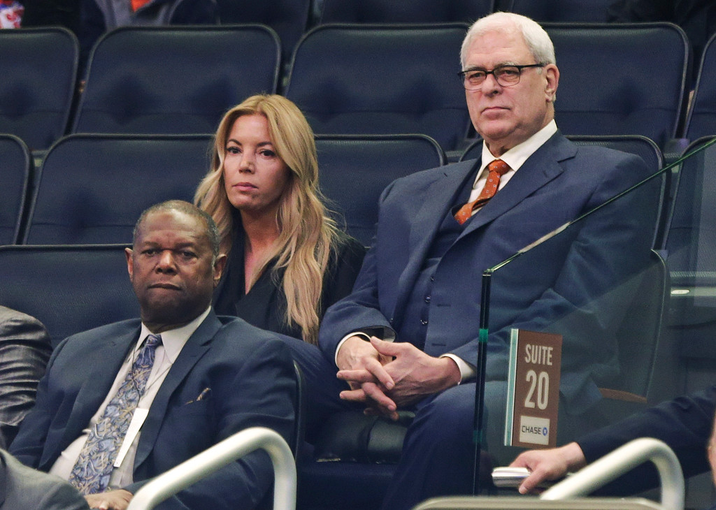 . Los Angeles Lakers owner Jeanie Buss, left, sits next to Phil Jackson, right, president of the New York Knicks, during the first half of an NBA basketball game between the Knicks and the Detroit Pistons on Wednesday, April 15, 2015, in New York. (AP Photo/Frank Franklin II)