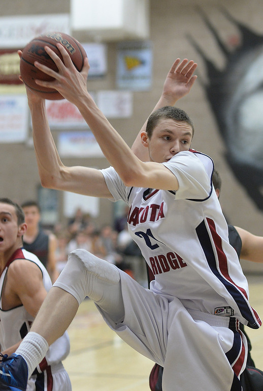 . LITTLETON, CO. - JANUARY 17: Dakota Ridge point Ian MacDonald secured a rebound in the second half. The Dakota Ridge High School boy\'s basketball team hung on to beat Chatfield 53-51 Friday night, January 17, 2014. Photo By Karl Gehring/The Denver Post