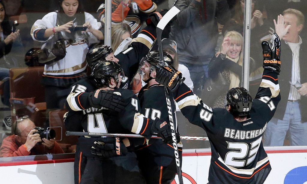. Anaheim Ducks right wing Corey Perry (10) celebrates his winning goal with teammates including Cam Fowler (4) and Francois Beauchemin (23) during overtime of an NHL hockey game against the Colorado Avalanche in Anaheim, Calif., Sunday, Feb. 24, 2013. The Ducks won 4-3. (AP Photo/Chris Carlson)