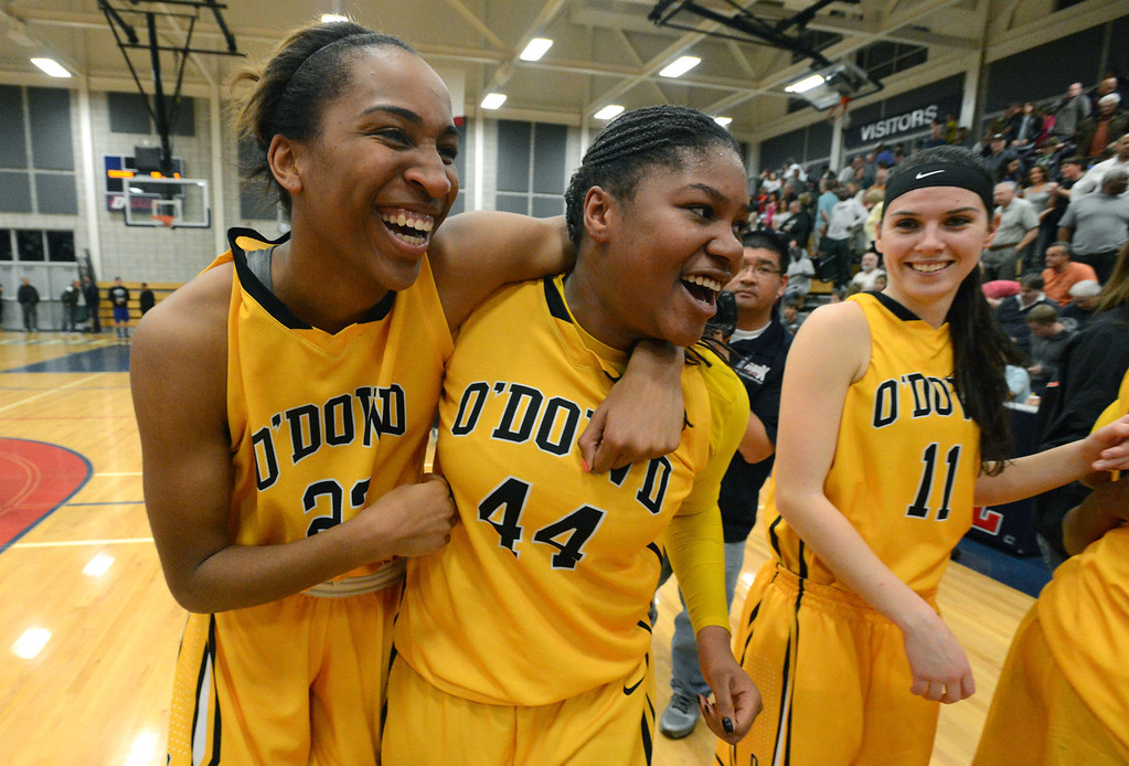 . Bishop O\'Dowd High\'s Oderah Chidom (22) left, and K.C. Waters (44) celebrate after their team won their Division III North Coast Section basketball game 77-48 against Miramonte High in Dublin, Calif., on Saturday, March 2, 2013. (Doug Duran/Staff)