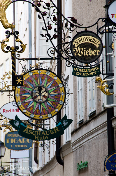 Business signs in Salzburg....see the locksmith's key?