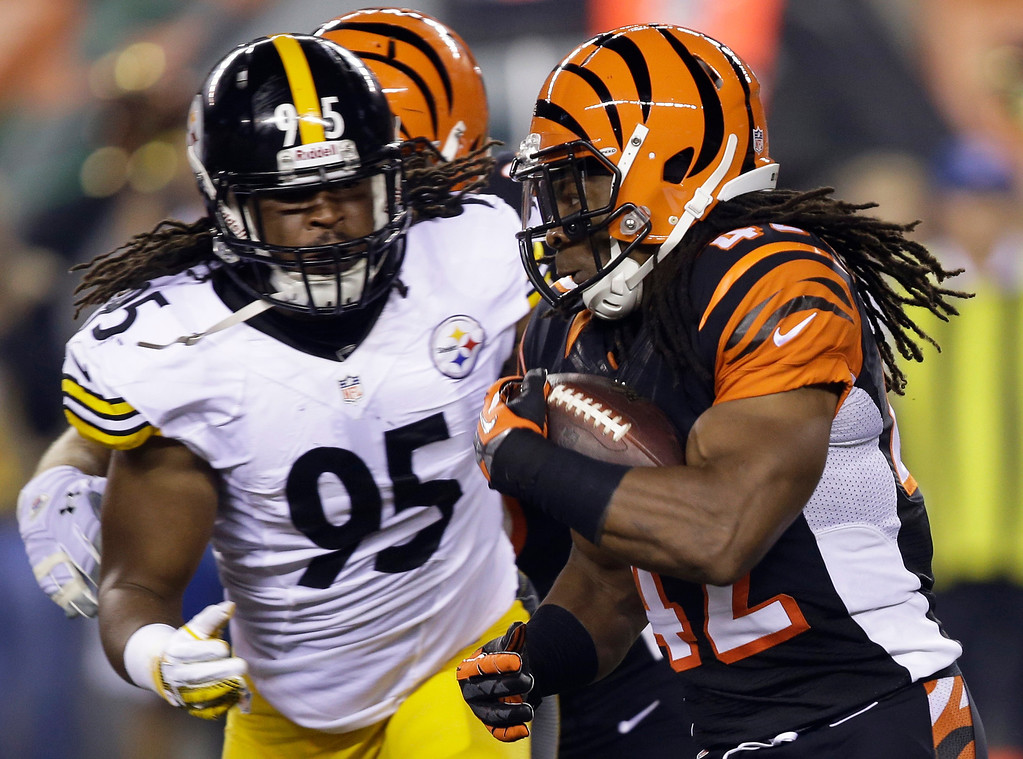 . Cincinnati Bengals running back BenJarvus Green-Ellis (42) runs against Pittsburgh Steelers linebacker Jarvis Jones (95) in the first half of an NFL football game, Monday, Sept. 16, 2013, in Cincinnati. (AP Photo/Al Behrman)
