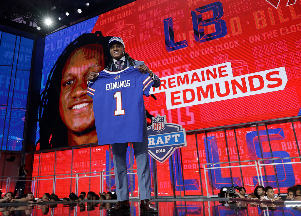 . Virginia Tech\'s Tremaine Edmunds poses with his Buffalo Bills jersey during the first round of the NFL football draft, Thursday, April 26, 2018, in Arlington, Texas. (AP Photo/David J. Phillip)