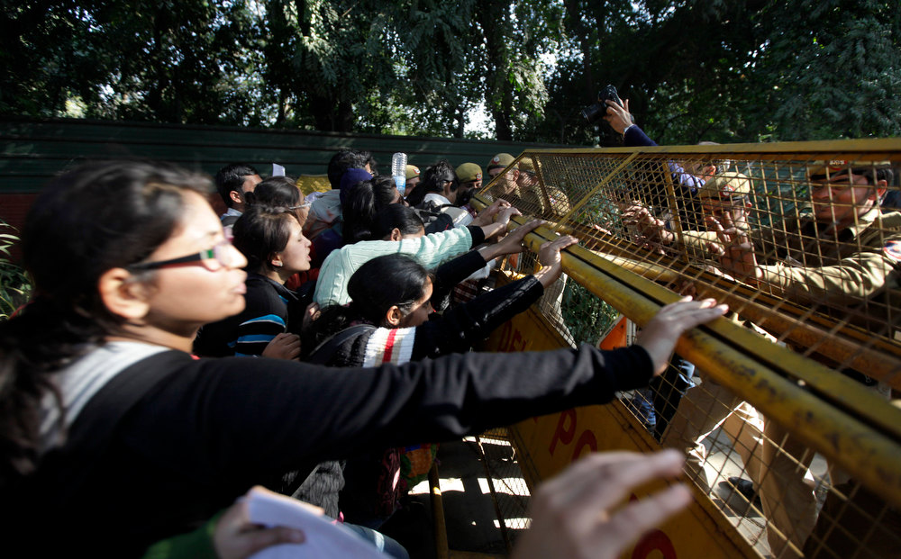 . Indian students try to break through a police barricade to reach the residence of Delhi state government Chief Minister Sheila Dikshit during a protest in New Delhi, India, Thursday, Dec. 20, 2012. The hours-long gang-rape and near-fatal beating of a 23-year-old student on a bus in New Delhi triggered outrage and anger across the country Wednesday as Indians demanded action from authorities who have long ignored persistent violence and harassment against women. (AP Photo/Altaf Qadri)