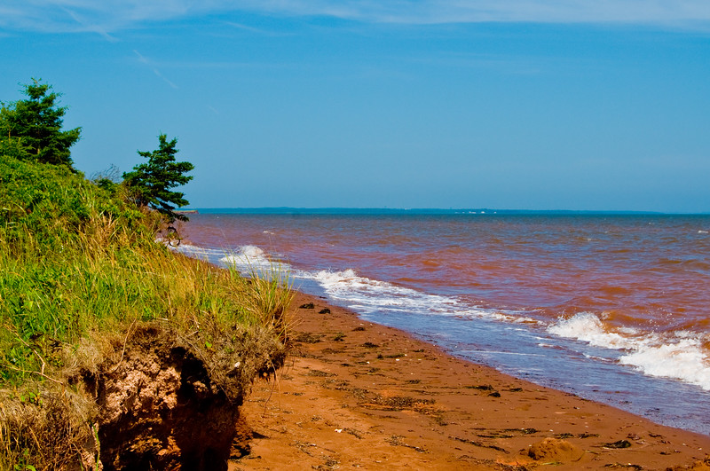 Looking out to sea - the reddish tint from the soil goes out a few dozen yards