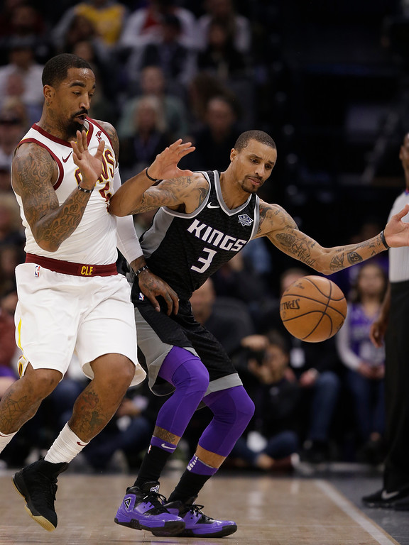 . Cleveland Cavaliers guard J.R. Smith, left, and Sacramento Kings guard George Hill chase after the ball as it goes out of bounds during the first quarter of an NBA basketball game, Wednesday, Dec. 27, 2017, in Sacramento, Calif. (AP Photo/Rich Pedroncelli)