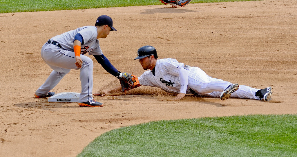 . Detroit Tigers shortstop Jose Iglesias, left, tags Chicago White Sox\'s Carlos Sanchez out after he was caught stealing second base during the fourth inning of a baseball game in Chicago on Sunday, June 7,  2015. (AP Photo/Matt Marton)