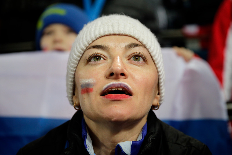 . Oksana Gritcaenko watches the women\'s biathlon 4x6k relay, at the 2014 Winter Olympics, Friday, Feb. 21, 2014, in Krasnaya Polyana, Russia. (AP Photo/Jae C. Hong)