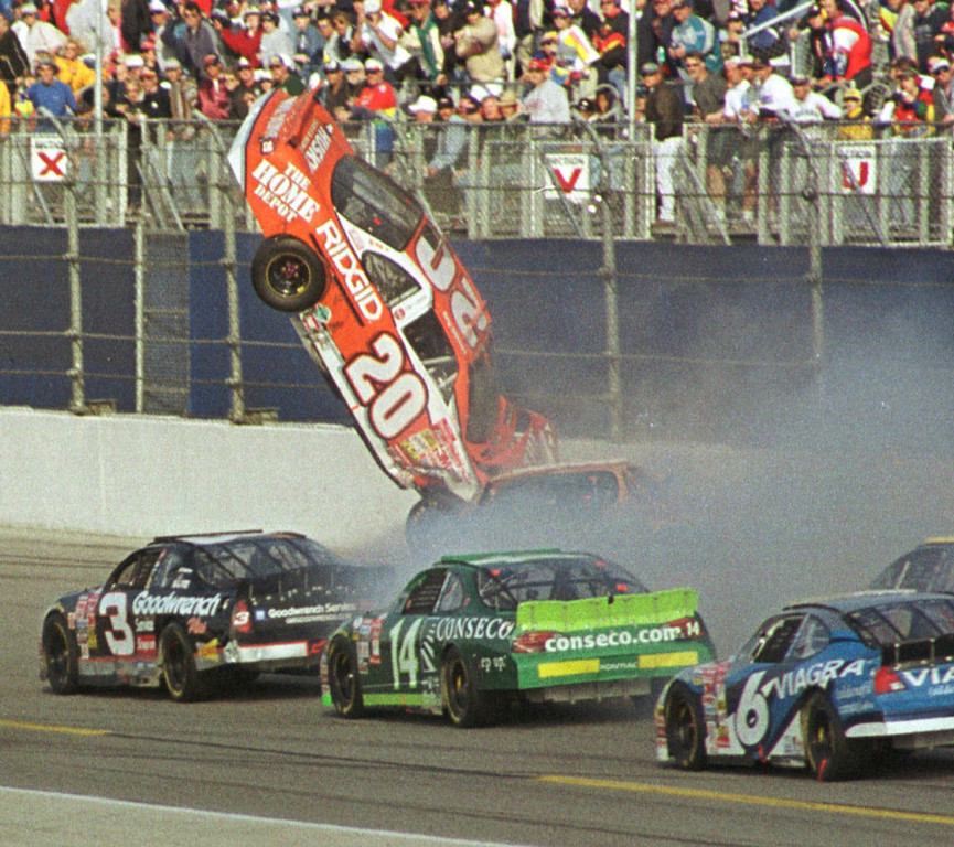 . Tony Stewart (20) flies through the air after an accident during the Daytona 500 Sunday afternoon, Feb. 18, 2001, at the Daytona International Speedway in Daytona Beach, Fla.  Getting by is Dale Earnhardt (3), Ron Hornaday (14) and Mark Martin (6). (AP Photo/Jim Topper)