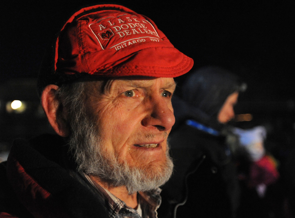 . Dan Seavey waits to see his son Mitch Seavey became a two-time Iditarod champion on Tuesday evening March 12, 2013.  (AP Photo/The Anchorage Daily News, Bill Roth)