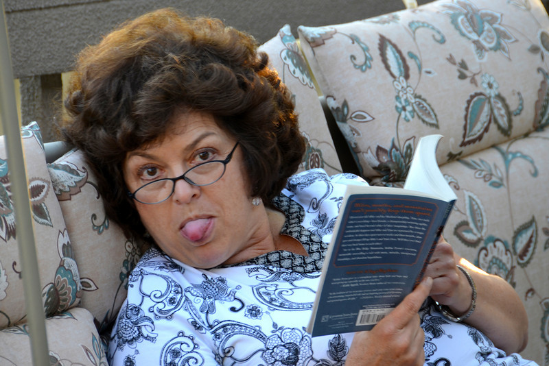 2012-9-28 ––– When I got home from work I tried to sneak a photo of Lisa out on her deck-swing reading. She must have heard me coming because this is the face she greeted me with.