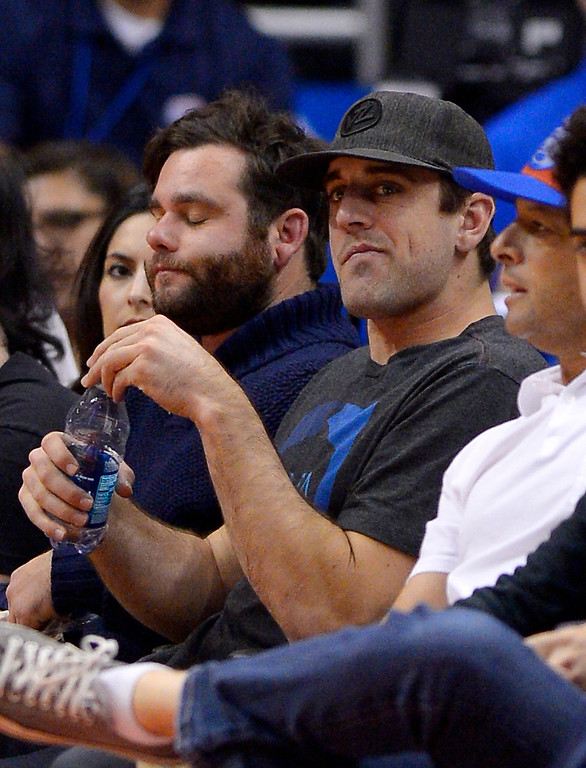 . Green Bay Packers quarterback Aaron Rodgers watches the Los Angeles Clippers play the Indiana Pacers during the second half of an NBA basketball game, Sunday, Dec. 1, 2013, in Los Angeles. (AP Photo/Mark J. Terrill)