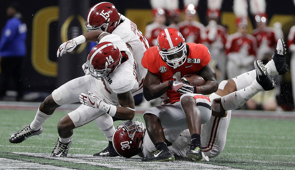 . Georgia running back Sony Michel runs for a first down during the first half of the NCAA college football playoff championship game against Alabama Monday, Jan. 8, 2018, in Atlanta. (AP Photo/David J. Phillip)