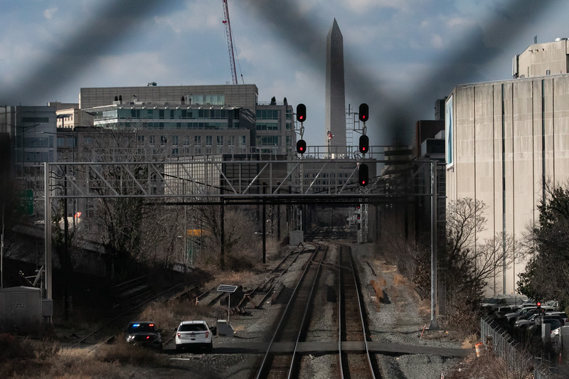 Police patrol train tracks in downtown Washington, D.C. on inauguration day