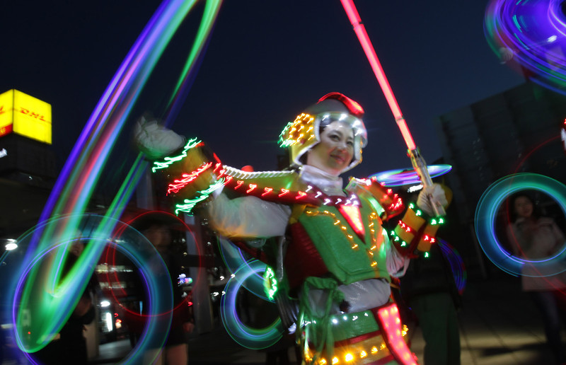 . Performers spin illuminated sticks during \'Cyber Jwibulnoli\' at Everland on February 21, 2013 in Seoul, South Korea. Jwibulnoli is originally played on the first full moon of the lunar year, that is February 25 this year.  (Photo by Chung Sung-Jun/Getty Images)