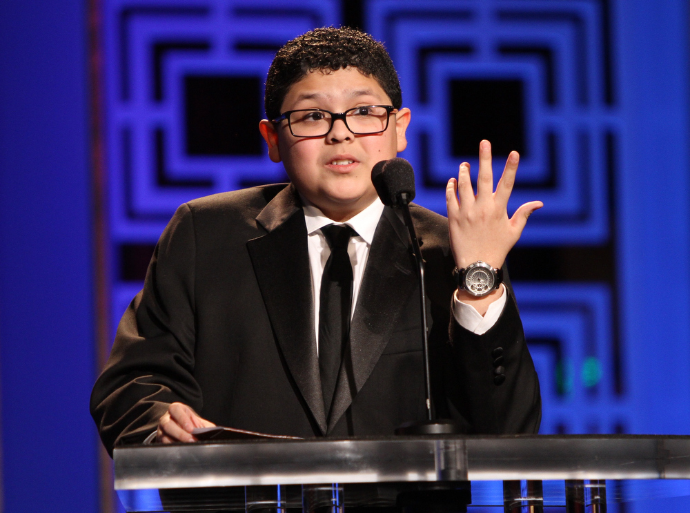 Description of . Actor Rico Rodriguez speaks onstage at the 2013 WGAw Writers Guild Awards at JW Marriott Los Angeles at L.A. LIVE on February 17, 2013 in Los Angeles, California.  (Photo by Maury Phillips/Getty Images for WGAw)