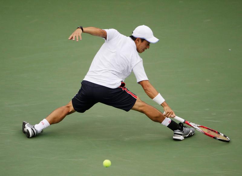 . Kei Nishikori, of Japan, returns a shot against Marin Cilic, of Croatia, during the championship match of the 2014 U.S. Open tennis tournament, Monday, Sept. 8, 2014, in New York. (AP Photo/Julio Cortez)