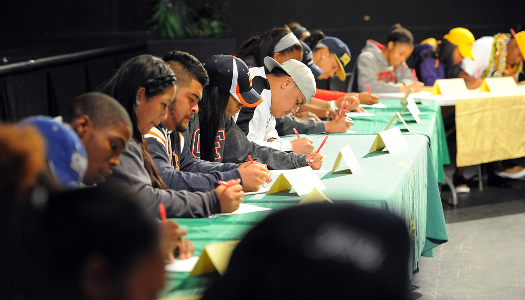 . 18 students athletes at Long Beach Poly sign their national letters of intent to play athletics at 4-year universities during a ceremony in Long Beach, CA on Wednesday, February 5, 2014. (Photo by Scott Varley, Daily Breeze)