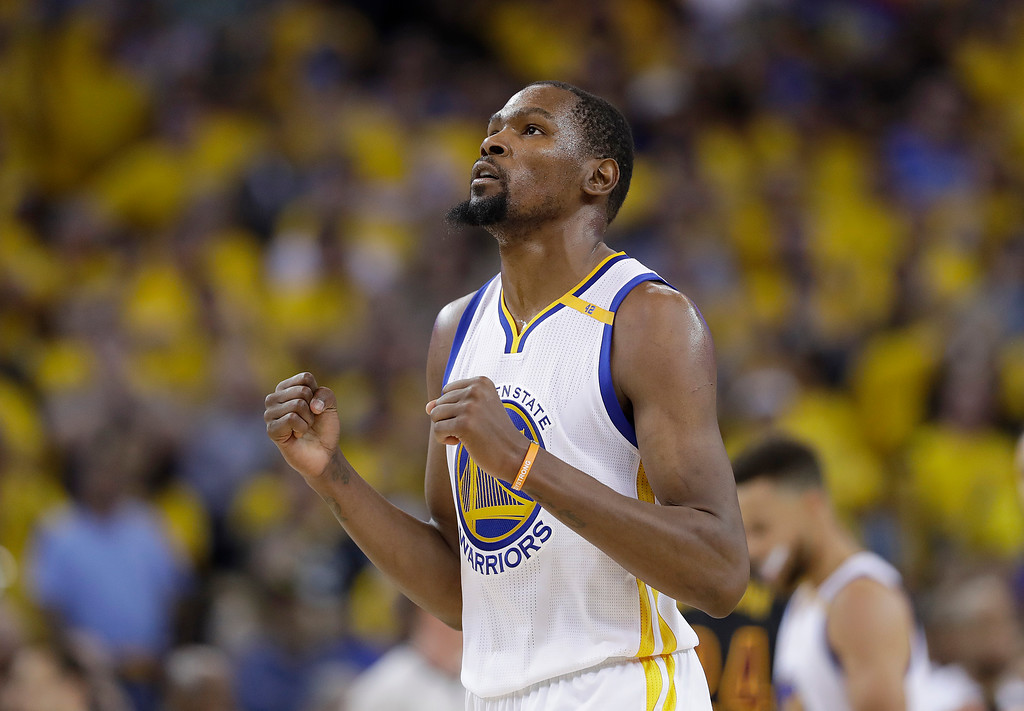 . Golden State Warriors forward Kevin Durant reacts after scoring against the Cleveland Cavaliers during the second half of Game 5 of basketball\'s NBA Finals in Oakland, Calif., Monday, June 12, 2017. (AP Photo/Marcio Jose Sanchez)