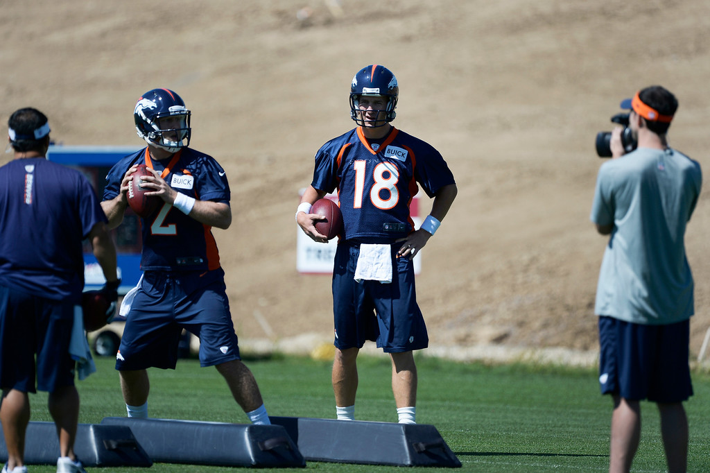 . Denver Broncos quarterback Peyton Manning (18) watches Zac Dysert (2) run through drills during OTAs June 2, 2014 at Dove Valley. (Photo by John Leyba/The Denver Post)