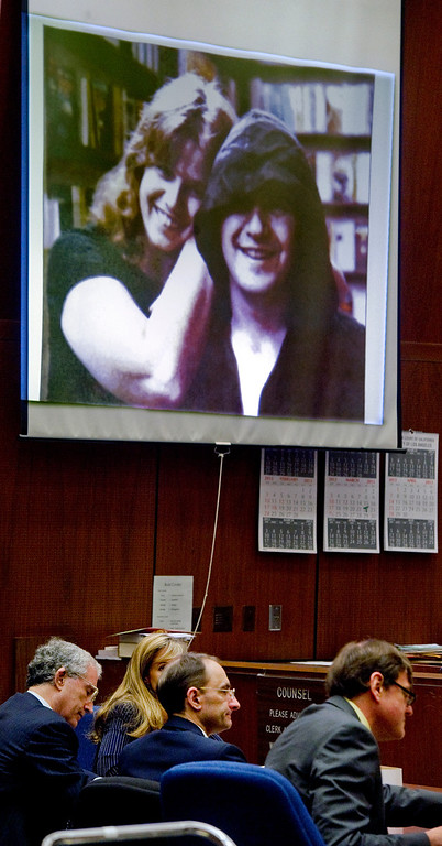 . Christian Karl Gerhartsreiter, center, with his lawyers adjacent to a projected photo of Linda and John Sohus on screen in courtroom at Clara Shortridge Foltz Criminal Justice Center in Los Angeles Monday, March 25, 2013.  A prosecutor told jurors Monday he will prove a cold-case murder allegation against the German immigrant who spent years moving through U.S. society under a series of aliases, most notoriously posing as a member of the fabled Rockefeller family. He has pleaded not guilty to the killing of John Sohus, 27, who disappeared with his wife, Linda, in 1985 while Gerhartsreiter, using an alias was a guest cottage tenant at the home of Sohus\' mother, where the couple lived.(Photo by Walter Mancini, SGVN)