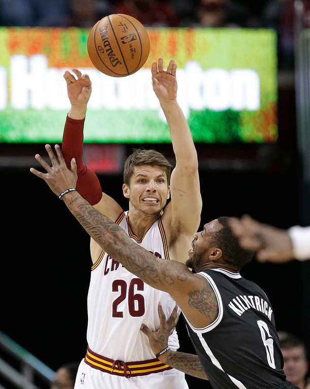 . Cleveland Cavaliers\' Kyle Korver (26) passes over Brooklyn Nets\' Sean Kilpatrick (6) in the first half of an NBA basketball game, Friday, Jan. 27, 2017, in Cleveland. (AP Photo/Tony Dejak)