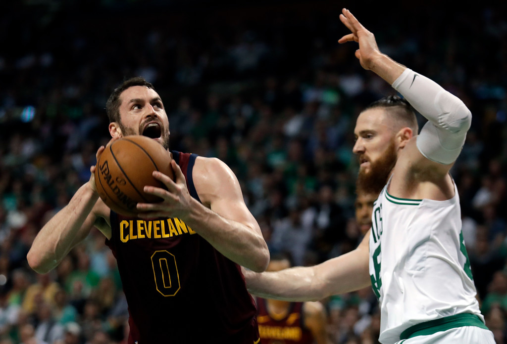 . Cleveland Cavaliers center Kevin Love, left, lines up a shot against Boston Celtics center Aron Baynes during the first half in Game 2 of the NBA basketball Eastern Conference finals Tuesday, May 15, 2018, in Boston. (AP Photo/Charles Krupa)