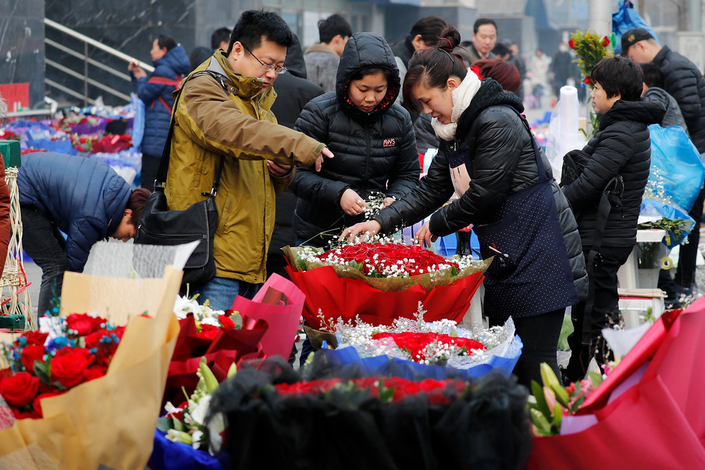 . A man buys Valentine\'s Day roses at the flower market in Beijing, Tuesday, Feb. 14, 2017. Valentine\'s Day is not a tradition in China but is becoming increasingly popular as Chinese adopt Western customs, encouraged by retailers who see them as a way of boosting sales. (AP Photo/Andy Wong)