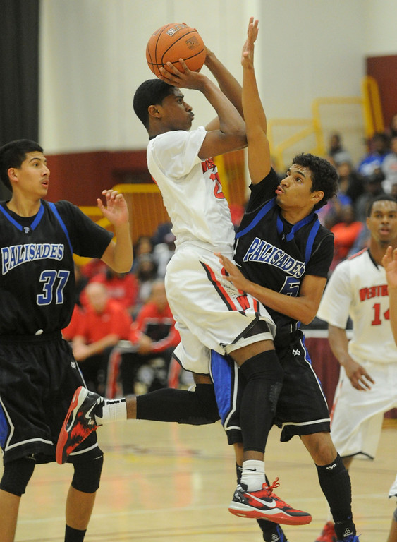 . 02-23-2012--(LANG Staff Photo by Sean Hiller)- Palisades vs. Westchester in Saturday\'s L.A. City Section Division I semifinal boys basketball game at Cal State Dominguez Hills in Carson. Palisades\' Ryan Ford (5) blocks Westchester\'s Myles Stewart (25) first half.