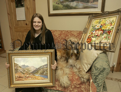 Cynara Turner pictured with Colins dog Lucy and two of his paintings, Spelga Dam and a stil life of flowers. 06W7N24