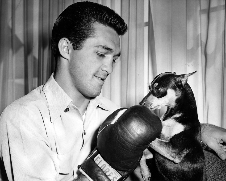 . Circa August 1957 - Middleweight Joey Giambra and his pet Trixie at home. (File Photo)
