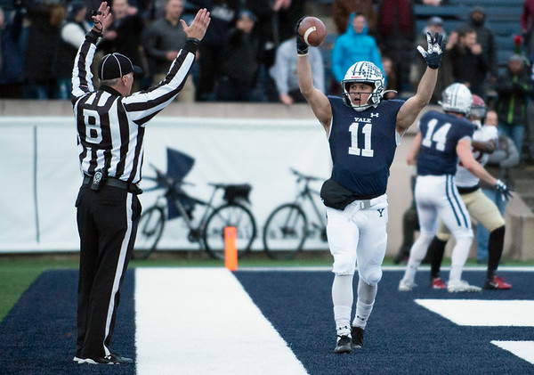 11/23/19 Wesley Bunnell | StaffrrYale rallied late in The Game against Harvard on Saturday afternoon at the Yale Bowl for a 50-43 victory in double over time. WR Caden Herring (11) signals touchdown song with the back judge.