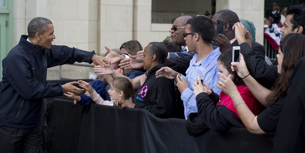 . US President Barack Obama greets people before speaking about rebuilding efforts following last year\'s Hurricane Sandy at the Asbury Park Convention Hall in Asbury Park, New Jersey, on May 28, 2013.    AFP PHOTO / Saul LOEB/AFP/Getty Images