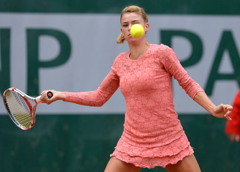 . Italy\'s Camila Giorgi hits a forehand shot to China\'s Shuai Peng during a French tennis Open first at the Roland Garros stadium in Paris on May 29, 2013.   MIGUEL MEDINA/AFP/Getty Images