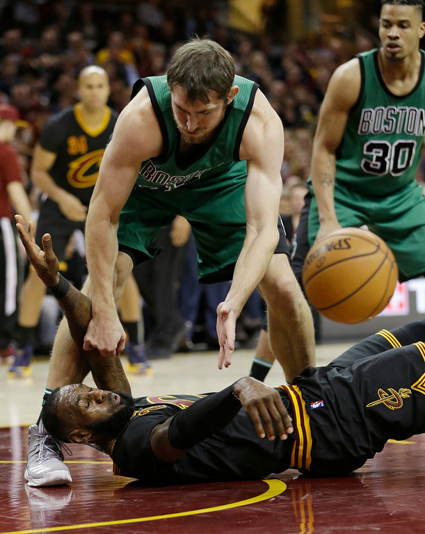 . Cleveland Cavaliers\' LeBron James, bottom, passes against Boston Celtics\' Tyler Zeller in the second half of an NBA basketball game, Thursday, Dec. 29, 2016, in Cleveland. (AP Photo/Tony Dejak)