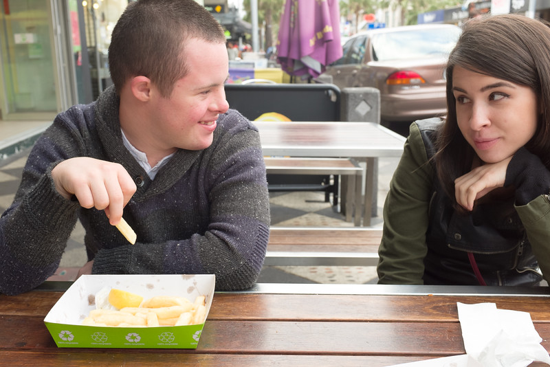 Man and Woman at a Street Cafe exchanging Glances
