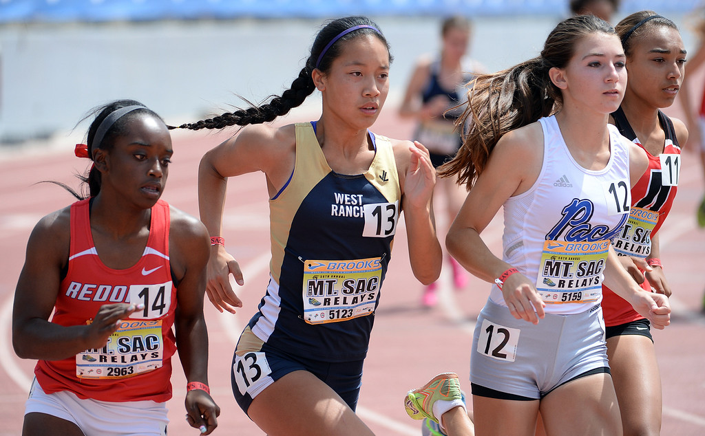 . West Ranch\'s Marisa Magsani (13) competes in the 800 meter run Invitational during the Mt. SAC Relays in Hilmer Lodge Stadium on the campus of Mt. San Antonio College in Walnut, Calif., on Saturday, April 19, 2014. 