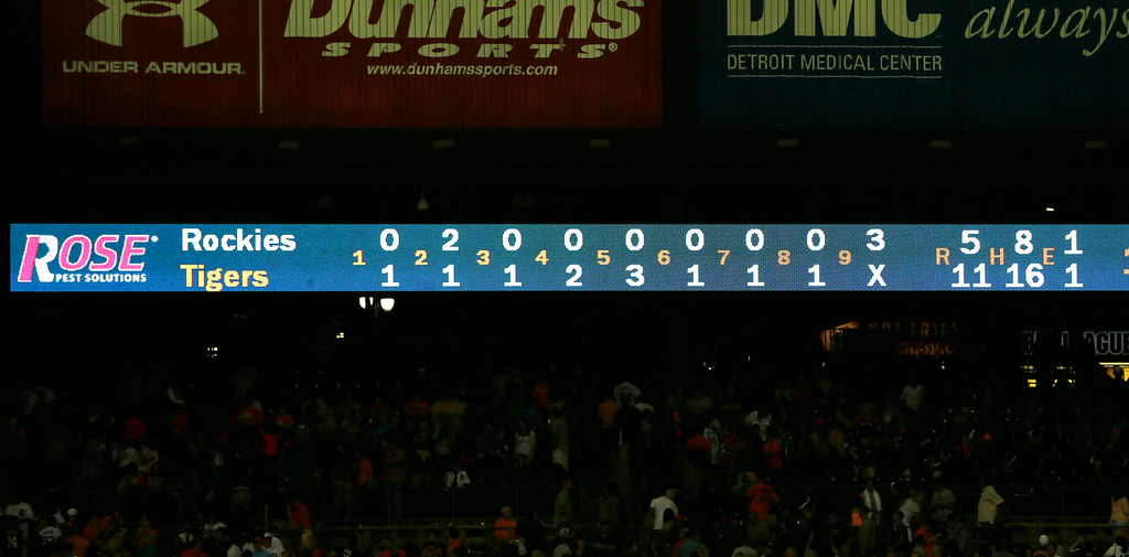 . The scoreboard is shown after the interleague baseball game between the Detroit Tigers and the Colorado Rockies, Saturday, Aug. 2, 2014, in Detroit. The Tigers become the first team to score in every inning since the N.Y. Yankees on April 29, 2006. (AP Photo/Carlos Osorio)