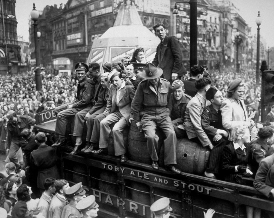 . 8th May 1945:  A van load of beer passing through Piccadilly Circus on VE Day. The statue of Eros, protected during the war by advertising hoardings, can be seen in the background.  (Photo by Keystone/Getty Images)