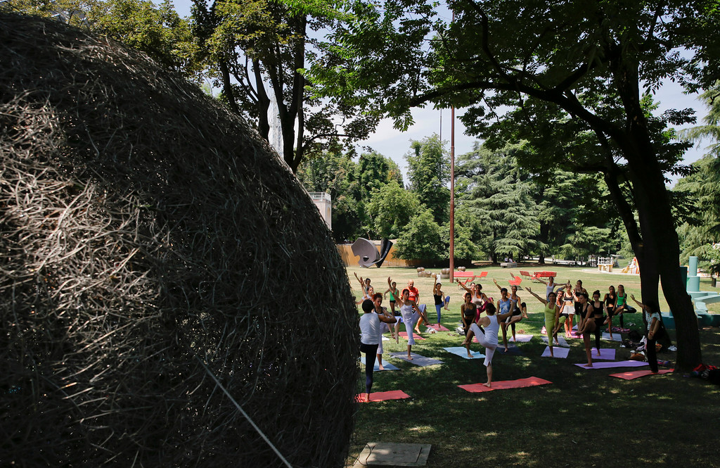 . People perform yoga to mark the International Yoga Day, in Milan, Wednesday, June 21, 2017. Thousands of yoga enthusiasts took part in mass yoga programs to mark International Yoga Day throughout the world. (AP Photo/Luca Bruno)