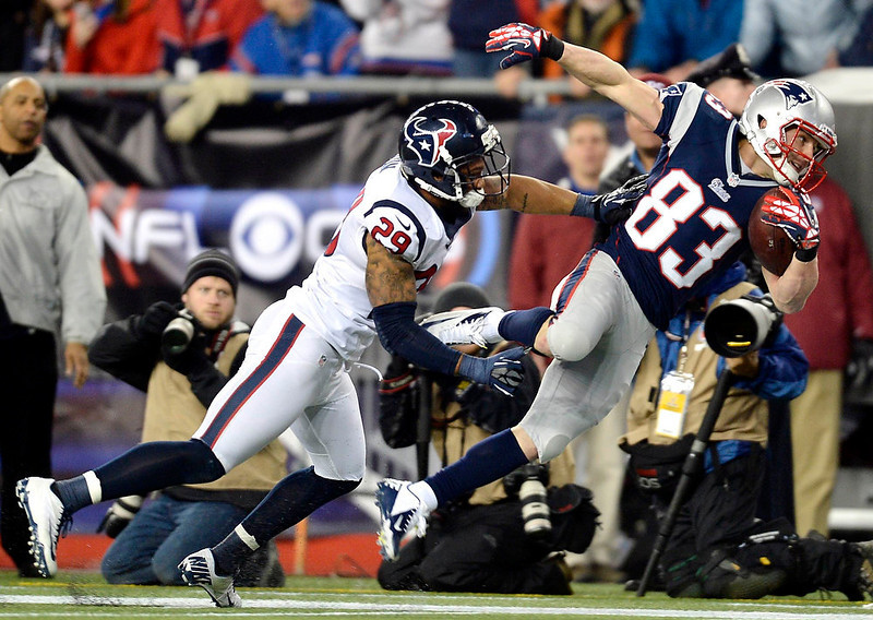 . New England Patriots wide receiver Wes Welker (83) makes a catch on a long pass from quarterback Tom Brady past Houston Texans\' Glover Quin during the second quarter of their NFL AFC Divisional playoff football game in Foxborough, Massachusetts January 13, 2013.    REUTERS/Gretchen Ertl