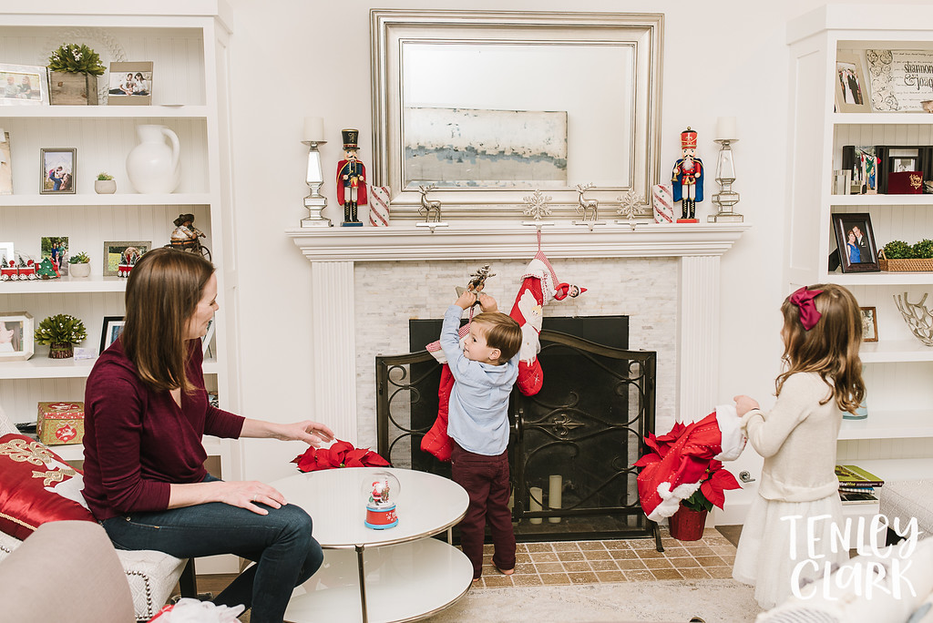 Little boy hanging stocking. Lifestyle in-home family photoshoot in Marin, CA by Tenley Clark Photography.