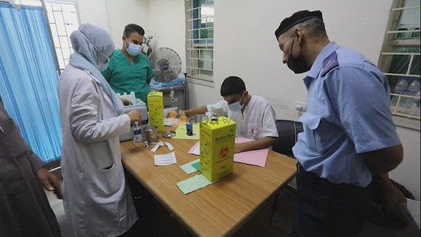 Palestinians get inoculated with a dose of the Covishield vaccine against the Covid-19 coronavirus